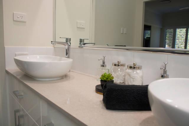 White bathroom vanity with granite bench